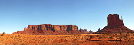 A panorama view of Monument Valley, Utah, USA, against blue sky. photo