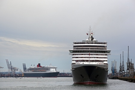 SOUTHAMPTON, UK - 5 JUNE: Cunard ship Queen Victoria sails in to meet Queen Elizabeth & Queen Mary 2 in the port of Southampton for the first time to celebarte the Diamond Jubilee. 5 JUNE 2012