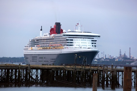 SOUTHAMPTON, UK - 5 JUNE: Cunard ship Queen Mary 2 sails in at dawn to meet Queen Elizabeth & Queen Victoria in the port of Southampton for the first time to celebrate the Diamond Jubilee. 5 JUNE 2012