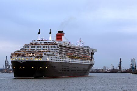 SOUTHAMPTON, UK - 5 JUNE: Cunard ship Queen Mary 2 sails in at dawn to meet Queen Elizabeth & Queen Victoria in the port of Southampton for the first time to celebratete the Diamond Jubilee. 5 JUNE 2012