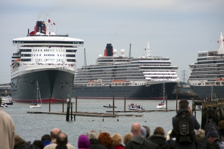 SOUTHAMPTON, UK - 5 JUNE: Cunard ships Queen Elizabeth, Queen Mary 2 & Queen Victoria meet in the port of Southampton for the first time to celebrate the Diamond Jubilee. 5 JUNE 2012