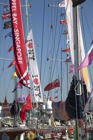 deatil: OCEAN VILLAGE, SOUTHAMPTON UK - JULY 22: Clipper Round the World Yacht Race. Deatil of the flags and banners as the yachts arrive in Southampton. 22 July 2012 Editorial
