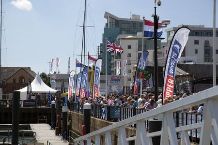 await: OCEAN VILLAGE, SOUTHAMPTON UK - JULY 22: Crowd await the yachts comleting the last keg of the Clipper Round the World Yacht Race,  Southampton. 22 July 2012
