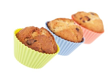 Three chocolate chip banana muffins  Intentional shallow Depth of Fie;d  photo