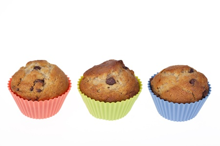 brown banana: Three Banana Chocolate Chip muffins in colourful silicone cases  Room for your text  Stock Photo