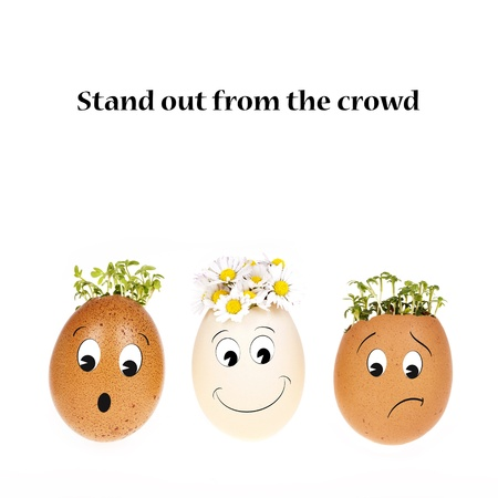 plant stand: Stand out from the crowd concept  Three eggheads with cartoon faces Stock Photo