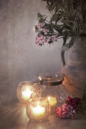 A vase of Sweet Williams by candlelight  Nostalgic, vintage effect with faded colours in style of early hand-painted photographs  photo