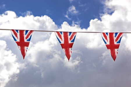 fete: Union Jack bunting against typical English summer sky.