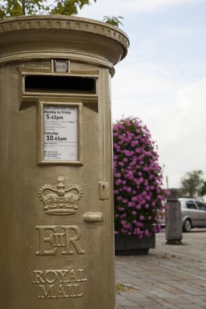 HAMBLE, NR SOUTHAMPTON, UK - 8 Aug 2012 - UK's Royal Mail honours Olympic Gold Medal winners, by transforming a post box from red to gold in the home town of each gold medallist. 8 Aug 2012