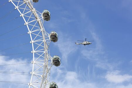Detail of the London Eye with helicopter flying past. Stock Photo - 14834123