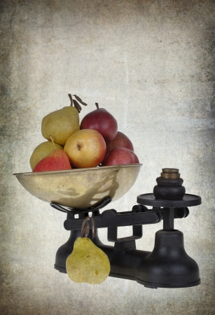 Weighing pears on vintage scales, with space for text photo