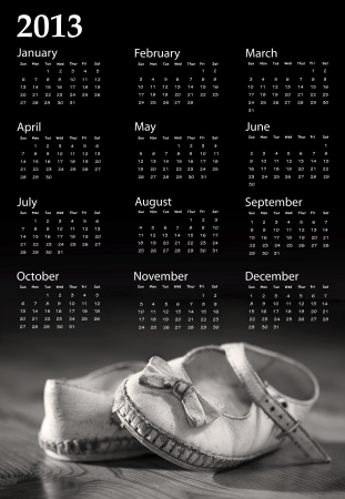 Nostalgic black and white image of worn out baby shoes with 2013 calendar photo