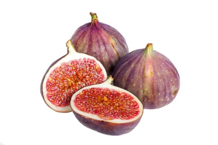 laxative: Fresh figs, whole and cut, isolated on white background.