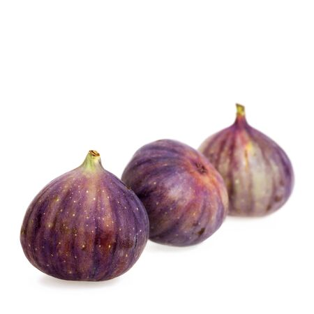 laxative: Figs on white background with space for text. Intentional shallow depth of field.
