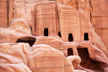 lost city: Cave dwellings in the Rose City of Petra, Jordan. The city of Petra was lost for over 1000 years but is now one of the new Seven Wonders of the World.