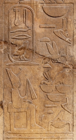 Hieroglyphs on ancient carving, Cairo, Egypt. photo