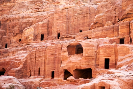 petra: Cave dwellings in the lost city of Petra, Jordan  Petra is one of the new Seven Wonders of the World and is also referred to as the Rose-Red city due to the colour of the rocks