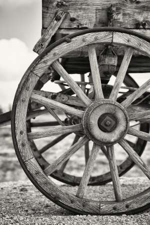 Closeup of the wheels of an old Wagon, Utah, USA. Black and white with slight sepia toning. photo