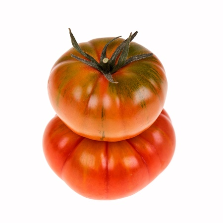heirloom: Two heirloom Marmande tomatoes in a stack and isolated on white. Marmande are a continental ribbed variety of beefsteak tomato.