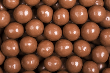 candy background: A background of milk chocolate sweets.  Stock Photo