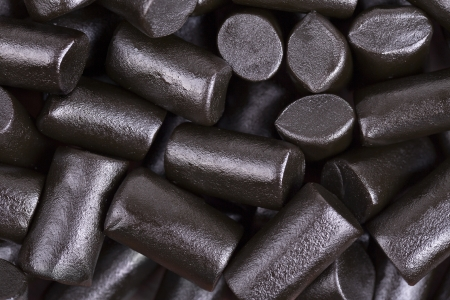 A background of cut pieces of soft black liquorice.