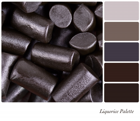 licorice: A background of cut pieces of liquorice in a colour palette with complimentary colour swatches Stock Photo