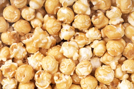 toffee: A background of fresh toffee coated popcorn