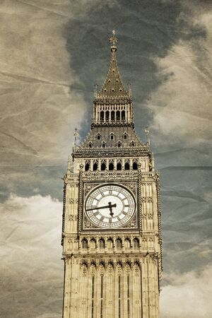 houses of parliament: A detail of the tower of Big Ben, Westminster, London. Vintage faded crumpled paper effect Stock Photo
