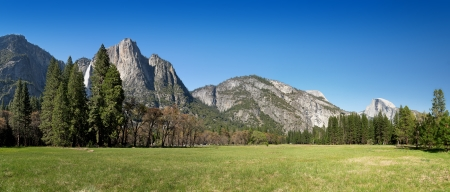 upper half: Yosemite Valley panorama showing the upper Yosemite Falls, the Half Dome with Yosemite meadow in the foreground Stock Photo
