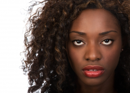 american curl: Closeup portrait of beautiful African American woman over white background. Stock Photo