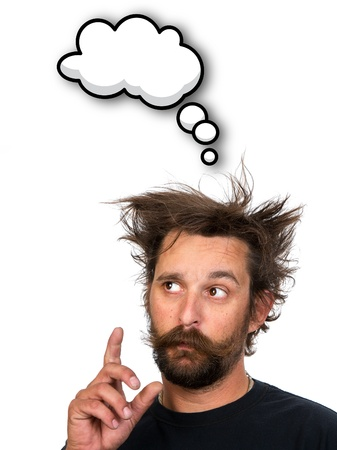 Goofy young man thinking, with thought bubble and space for your text. Isolated on white background