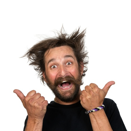 funny bearded man: Goofy young man grins at the camera while giving a thunbs up sign. Isolated on white background.