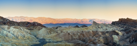 Panorama of The Badlands and Zabriskie point at sunrise. Death Valley National Park, California, USA photo