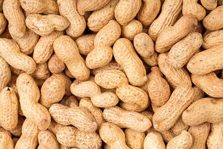monkey nuts: A background of of whole monkey nuts Stock Photo