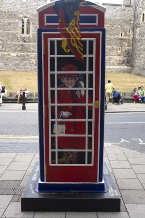 reigning: WINDSOR, UK - JULY 21: The Queen, Elizabeth II, depicted on Timmy Mallets Ring a Royal Post Box. Art installation celebrating all things British, on July 21, 2013 in Windsor, UK.