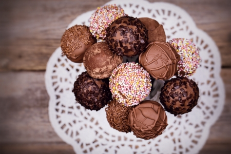 cake pops: Chocolate cake pops in a white jug. Overhead view with intentional selective focus. Vintage effect. Stock Photo
