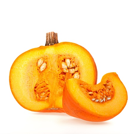 Cross-section and wedge of a pumpkin over white background