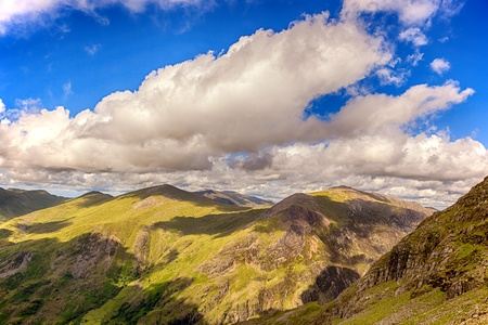 Blue sky and clouds across the mountains of Snowdonia, North Wales, UK photo