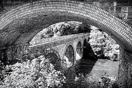 Gritty black and white study of a bridge under a bridge. North Wales, UK photo
