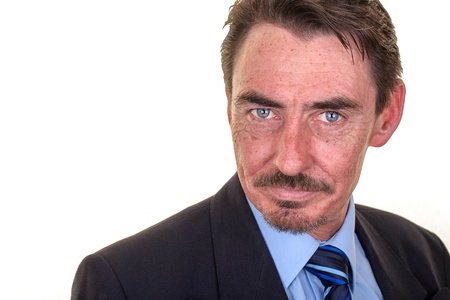 business for the middle: Attractive middle aged business man with intense blue eyes. Studio shot over white with space for text. Stock Photo