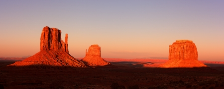 Panorama of the Mitten Buttes of Monument Valley at sunset, Utah, USA