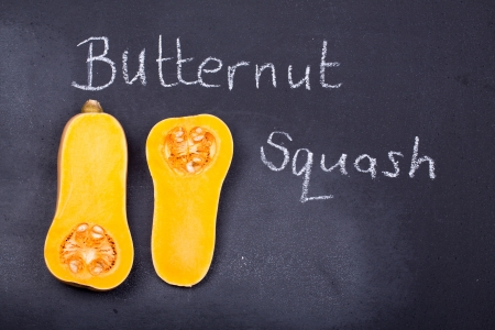 Halved butternut squash on a chalkboard background photo