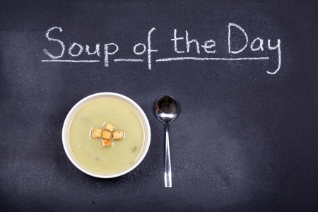 potato soup: Chalkboard advertising the soup of the day, with a bowl of leek and potato soup and spoon, garnished with bread croutons, and space for your text
