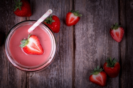 strawberry: Strawberry smoothie in glass jar, over old wood table  Vintage effect with intentional vignette