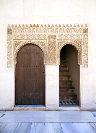 Ornate door and staircase. Nazrid Palace, Alhambra, Spain