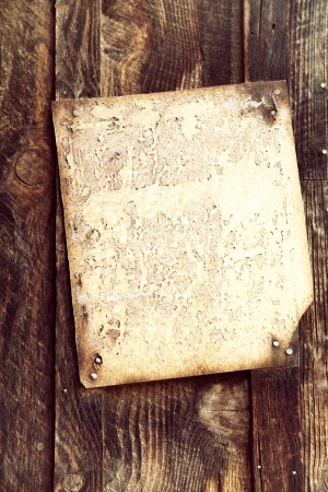 Old wood background with faded blank document attached. Space for your text. Archivio Fotografico