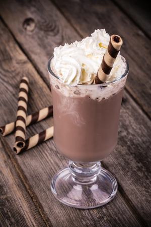 hot drink: Hot chocolate with whipped cream topping, in glass with  rolled wafer. Vintage effect processing