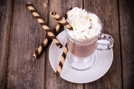 hot cold: Hot chocolate with whipped cream topping, in glass with  rolled wafer. Vintage effect processing