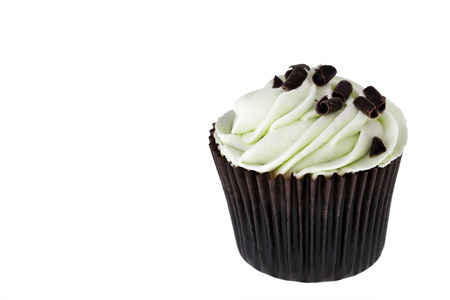 Mint chocolate chip cupcake on white background with space for text. photo