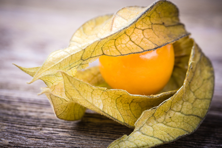 cape gooseberry: Physalis, or Cape Gooseberry fruit over old wood background. Vintage effect with intentional vignette
